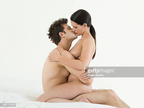 Naked men and women making out